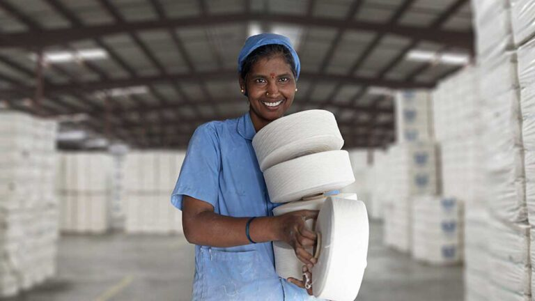 Textile worker with cotton spools.