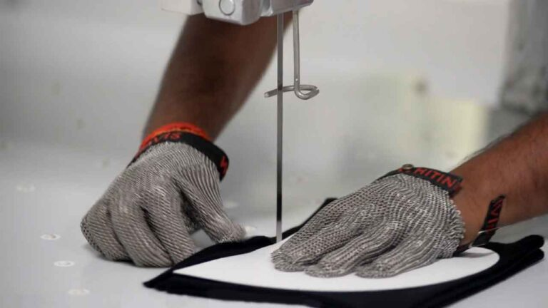 Ethical Fashion health and safety: Pattern cutting with chain-mail gloves.
