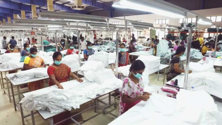 Ethical Fashion: Textile workers in PPE constructing garments.