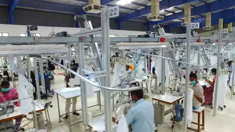 Ethical Fashion: Textile workers finishing garments.