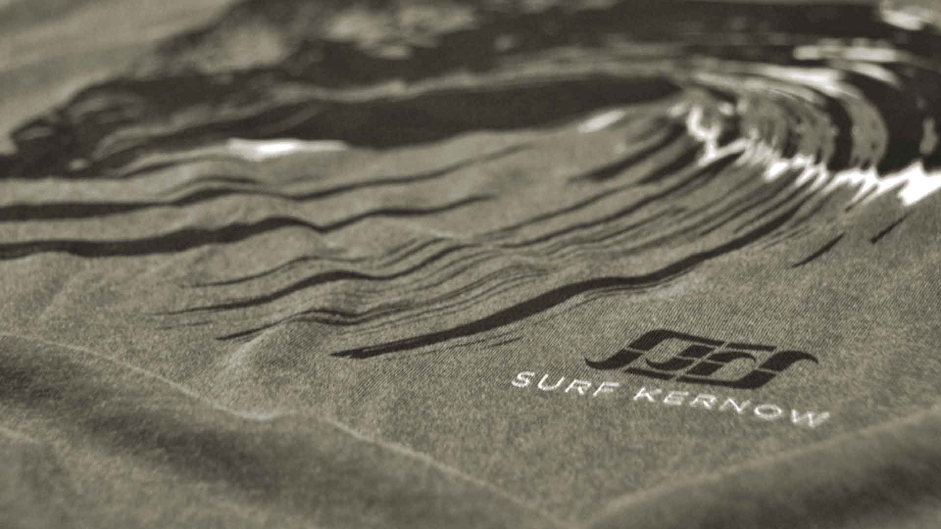Contact us – Close up of organic cotton t-shirt featuring SURF KERNOW logo.