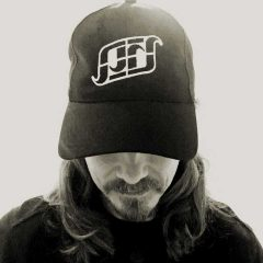 Greg Matthews wearing a Surf Kernow organic cotton baseball cap.